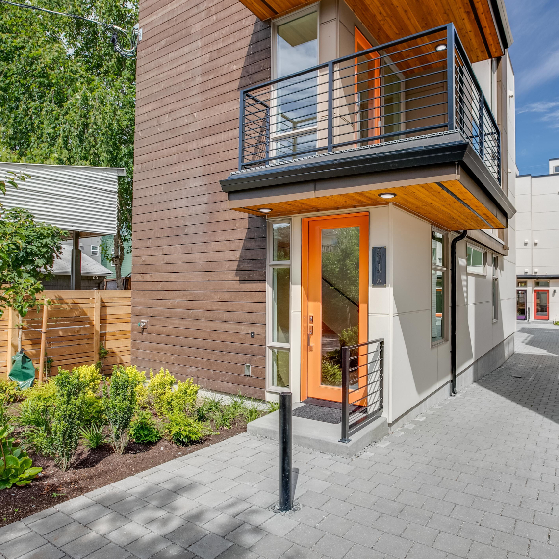 Haberzetle Homes Playful All-Electric 4-Star Townhomes exterior entry and garden