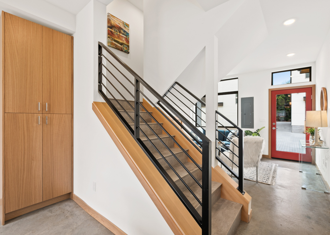 Haberzetle Homes Playful All-Electric 4-Star Townhomes stairway and storage